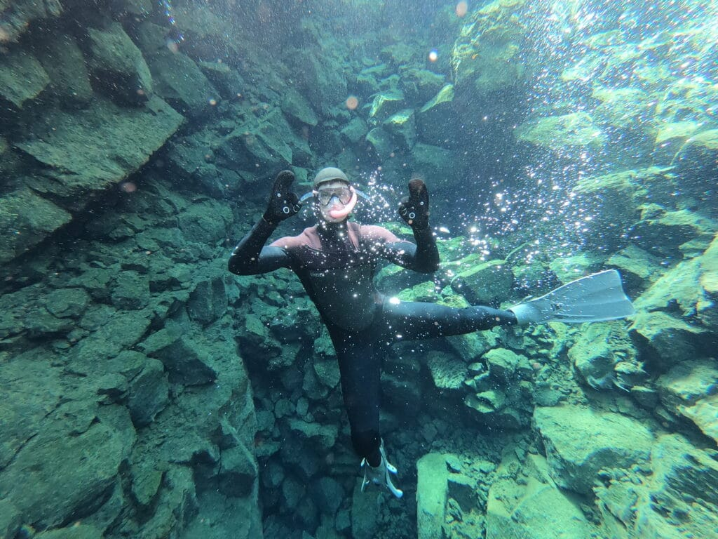 Diving down whilst snorkeling in Iceland